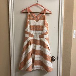 Beautiful textured mini dress w back cross straps